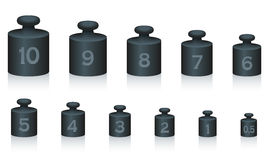 Weight Masses Black Iron. Weight masses of black iron for maths and physics, from one to ten, plus half unit - for calculating, counting and weighing - isolated Royalty Free Stock Image