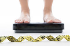 Weight measure scale with measuring tape, woman measurement Royalty Free Stock Images