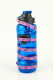 Weight Measuring Tape Wrapped Around Blue Water Bottle Royalty Free Stock Photos