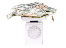 Weight of money Royalty Free Stock Image