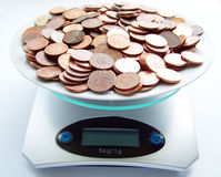 Weight of money Stock Photo