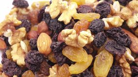 Nuts and dried fruits in bulk. Weight of nutmixture in bulk on a white background stock video