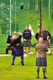Weight over the bar event, Highland Games Royalty Free Stock Photos