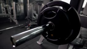 Weight plates on barbell bar, high quality equipment, gym maintenance, closeup. Stock photo stock images