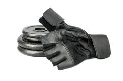 Weight plates and gloves Royalty Free Stock Photography