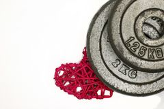 weight plates and red rattan stock image