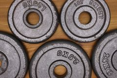 Weight plates. On a wooden floor Royalty Free Stock Image