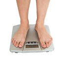 Weight scale. Womanish feet on weight scale royalty free stock photo