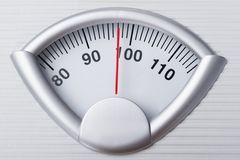 Weight scale. Closeup photo of weight scale showing overweight royalty free stock photography