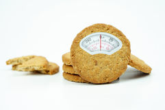 Weight scale composite on grain cookies on white background. Weight scale composite on grain cookies isolated on white background stock photo