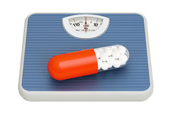 Weight scale with diet pill, 3D rendering. On white background Stock Images