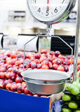 Weight scale in fruit and veg market Royalty Free Stock Image