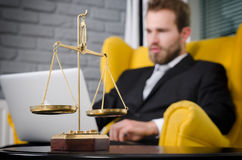 Weight scale of justice, lawyer in background. Lawyer document agreement attorney scales authority background balance concept Stock Photos