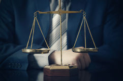 Weight scale of justice, lawyer in background Royalty Free Stock Photography