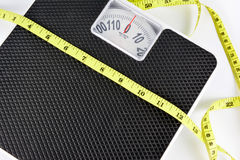 Weight scale and measuring tape. Royalty Free Stock Image