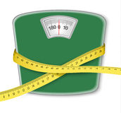Weight scale with a measuring tape. Concept of diet. Royalty Free Stock Photo