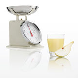 Weight scale with pear juice glass isolated on white background, Stock Image