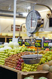A weight scale in the produce area Stock Images