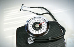 Weight scale with stethoscope Royalty Free Stock Photography