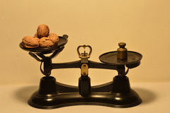 Weight on scale. Weighing scale weight with walnuts Stock Photos