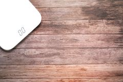 Weight scale white digital on the wooden backgrounds health and fitness life concept Royalty Free Stock Photo