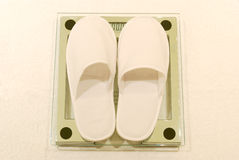 Weight Scale with White Hotel Slippers Stock Photography