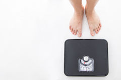 Weight scale ,woman measure weightloss Royalty Free Stock Images