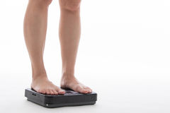 Weight scale. Woman measure weightloss with isolated whie background stock images