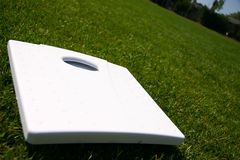 Weight scales on green grass. Outside Stock Photo