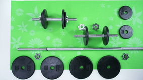Weight Set on Mat. Iron Hand weight set exploded view build stock video footage