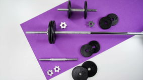 Weight Set on Mat. Iron Hand weight set exploded view build stock video