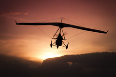 Weight-Shift ultralight aircraft. Silhouette in the sunset Royalty Free Stock Photography