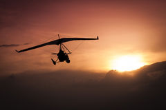 Weight-Shift ultralight aircraft. Silhouette in the sunset Stock Image