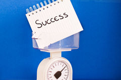 Weight of success, balance measuring pros & cons. Metaphor of balance measuring ups and downs of success Stock Image
