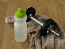 Weight Training. Tools like water bottle, dumbell weights and a sweat towel Royalty Free Stock Photos
