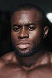 Weight training African bodybuilder portrait Stock Photos
