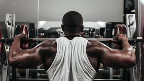Weight training African doing bodybuilding Stock Photo