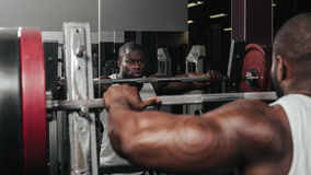 Weight training African doing bodybuilding Royalty Free Stock Photography