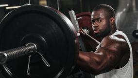 Weight training African doing bodybuilding Royalty Free Stock Image