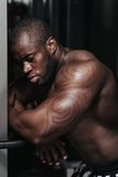 Weight training African doing bodybuilding Stock Photos