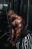 Weight training African doing bodybuilding Stock Photography