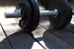 Weight training dumb bell on outdoor patio deck Stock Photography