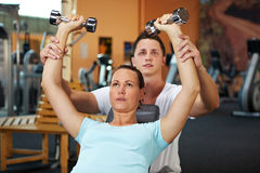 Weight training with fitness coach stock photos