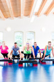 Weight training in the gym Royalty Free Stock Photos