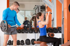 Weight training at gym Stock Photos