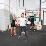 Weight training with personal trainer Royalty Free Stock Image