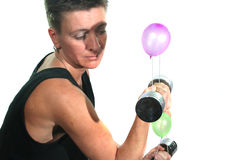 Weight training for wimps. Strength training with aerial balloons in the dumbbells stock photography