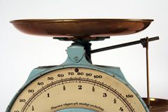 Weight watcher (1). Old kitchen scale with brass pan Stock Photography