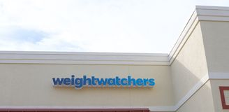 Weight watchers Store Sign. Weight Watchers International is an American company that offers various products and services to assist weight loss and maintenance stock images