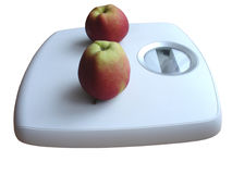 Weight watching. Weighing scales with apples Stock Photo